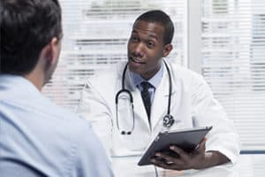 male doctor talks to patient about detox