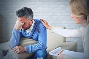 Therapist showing emotional support toward man