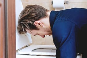 man vomiting and having dextroamphetamine withdrawals