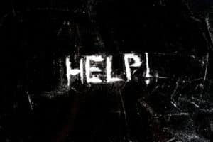 """""""Help"""" spelled in cocaine powder"""