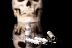 Cocaine on table with skull in background